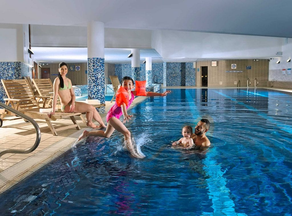 Family relaxing in the swimming pool at Clayton Hotel Liffey Valley